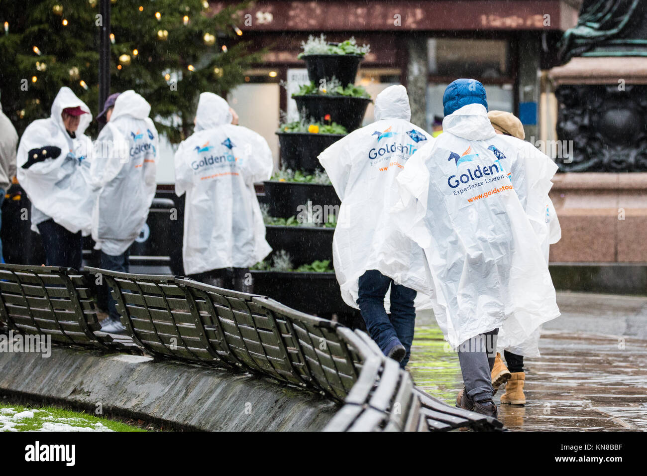 Windsor, UK. 11th Dec, 2017. Tourists arrive well-equipped to brave heavy rain on a visit to Windsor Castle. Credit: - Stock Image