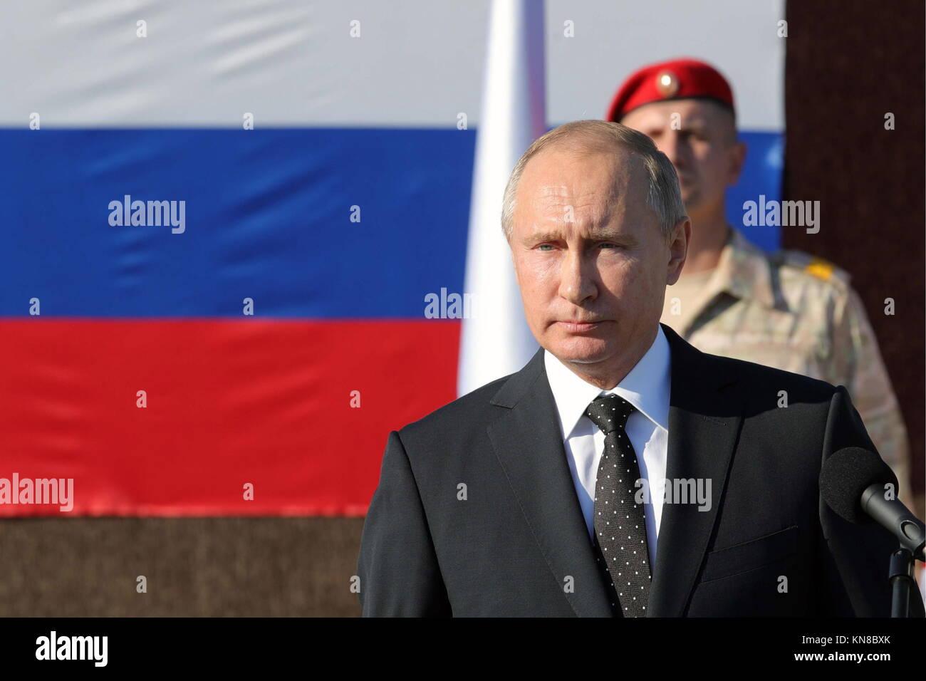 Latakia, Syria. 11th Dec, 2017. Russia's President Vladimir Putin (front) at the Russian Hmeimim air base. Putin - Stock Image