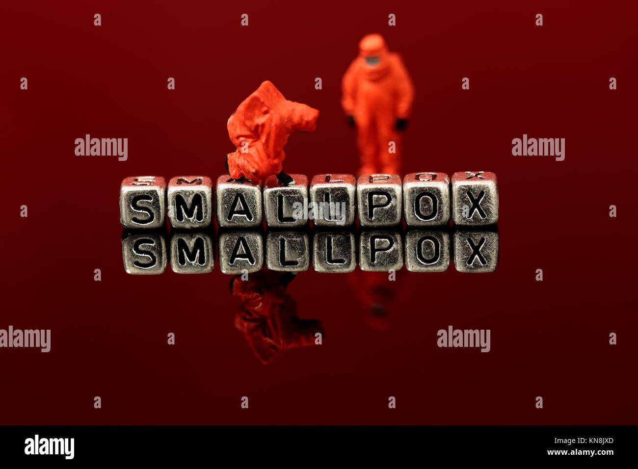 Smallpox on beads with miniature scale model chemical team - Stock Image