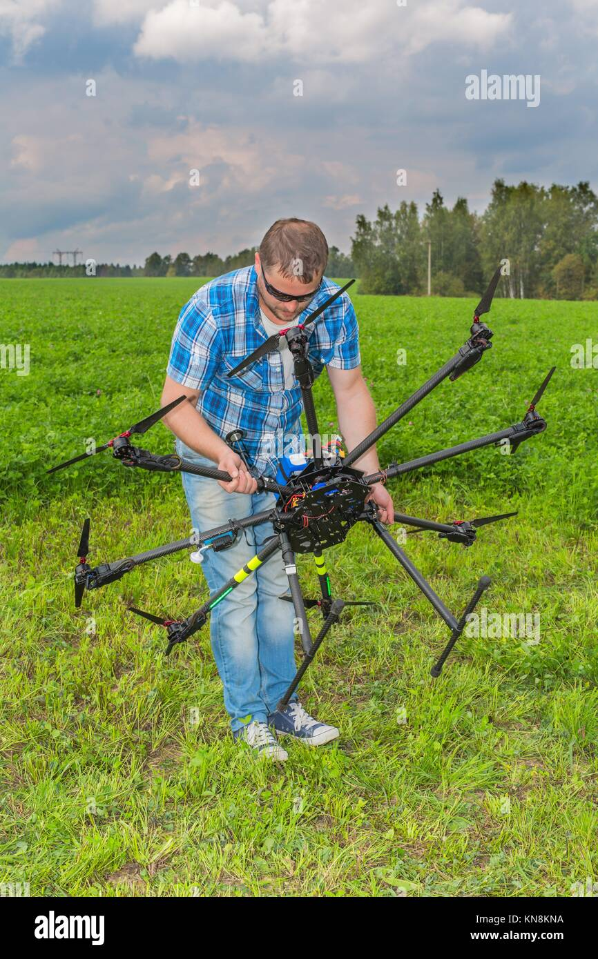 Technician calibrating multicopter' compass pilot copter aviation. - Stock Image