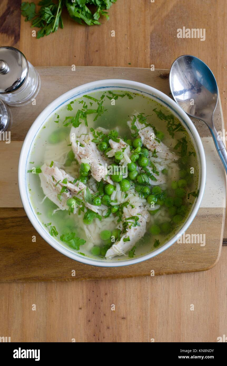 Chicken and pea broth with orzo pasta. - Stock Image