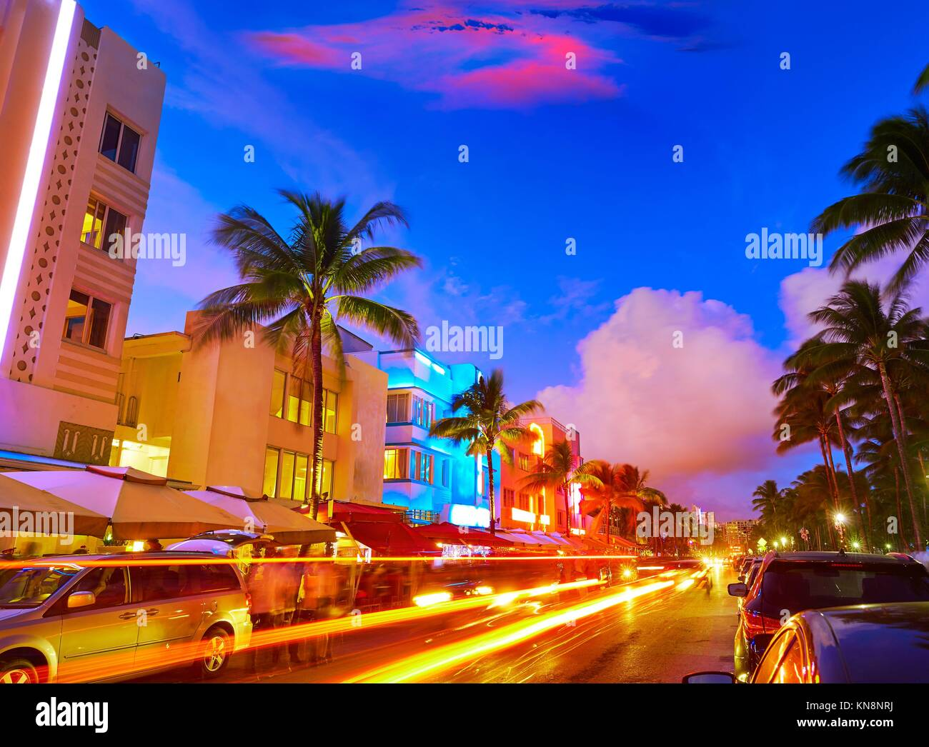 Miami Beach South Beach sunset in Ocean Drive Florida Art Deco and car lights. - Stock Image