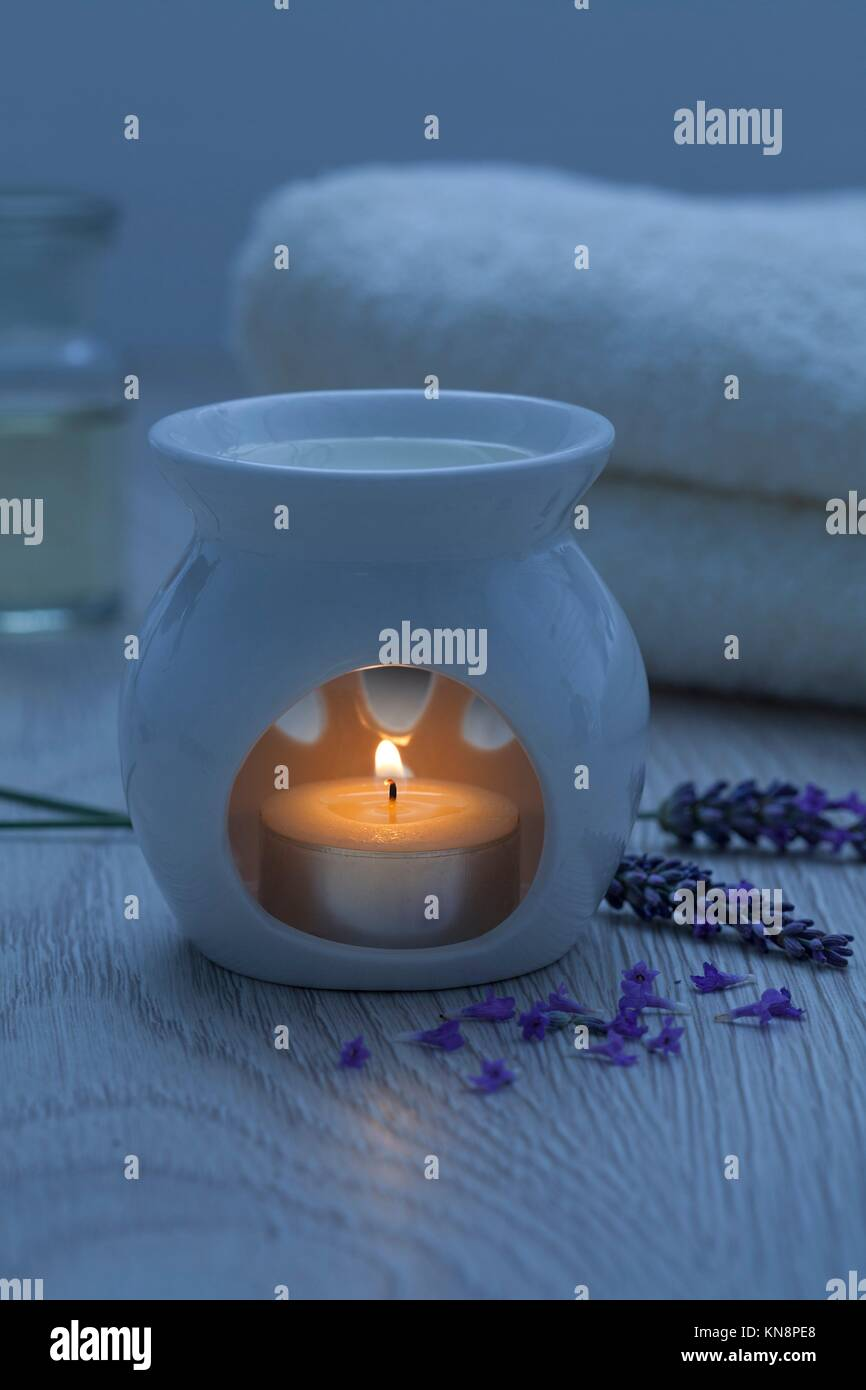 Candle for aroma therapy with lavender oil. - Stock Image