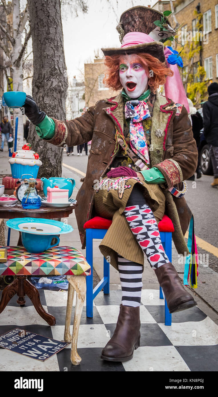 A street performer dressed as Johnny Depp's colourful but crazy Mad Hatter character near the market in Portobello, - Stock Image