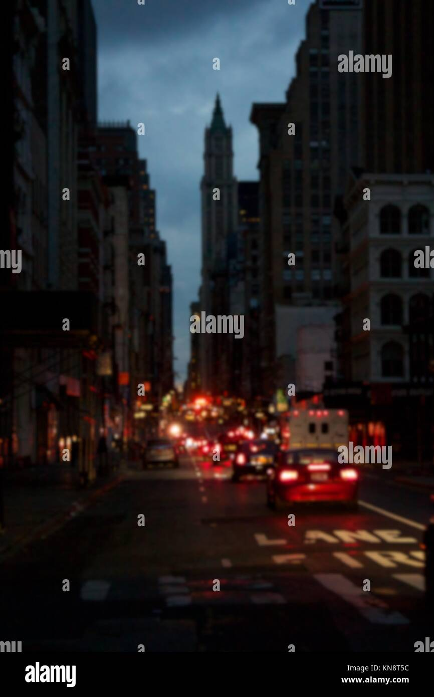 Background blur of darkness over blacked-out streets of Lower Manhattan in New York, NY, USA, after Hurricane Sandy. - Stock Image