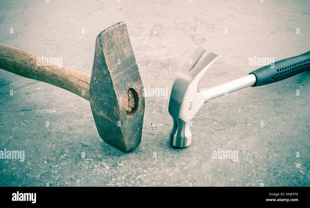 Hammer still life. Two hammers side by side on a stone workbench. Symbol of strength and force. Concept of industrial - Stock Image