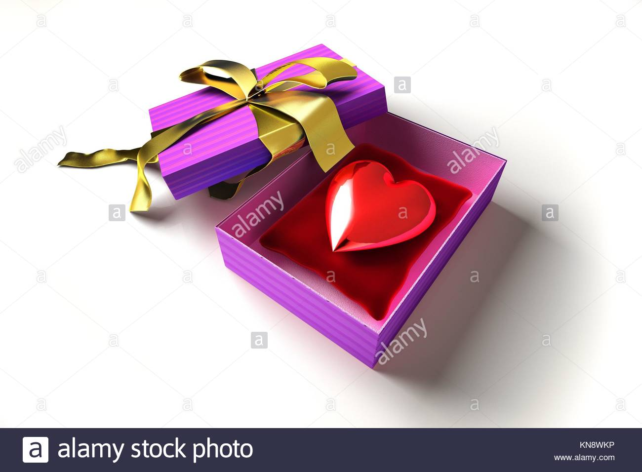 Gift package, with ribboned open cup, with a shiny heart inside, on a white surface. Stock Photo