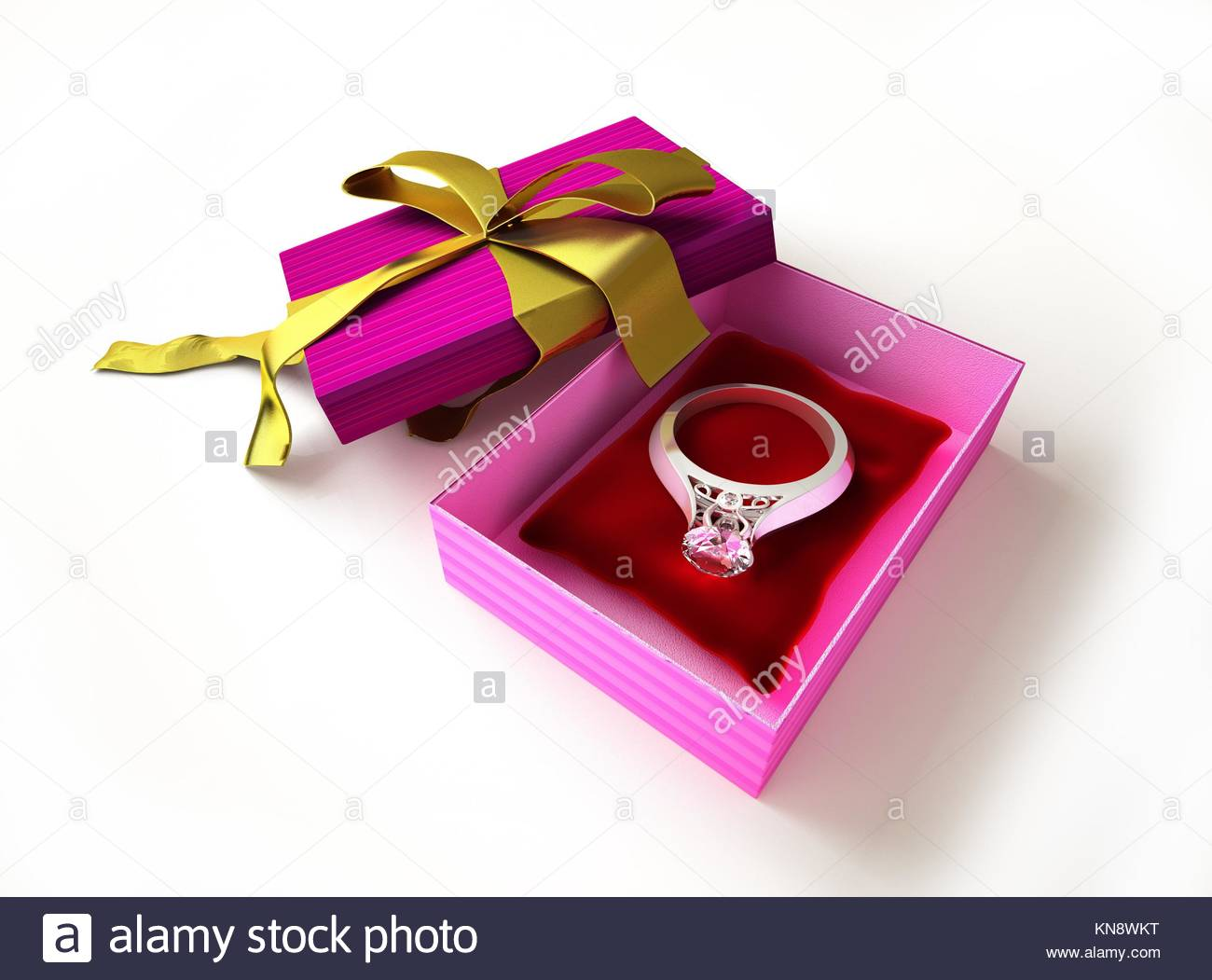 Gift package, with ribboned open cup, with ring and diamond on a pillow, inside. Stock Photo