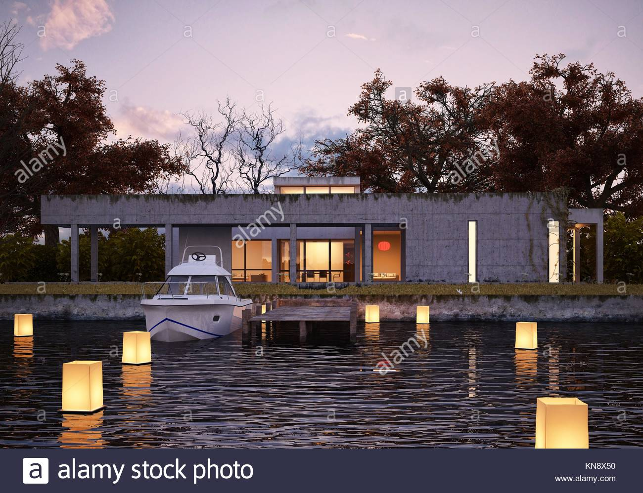 Luxury modern house on water at sunset, with private peer and yacht. Glowing lights floating on water give spacial - Stock Image
