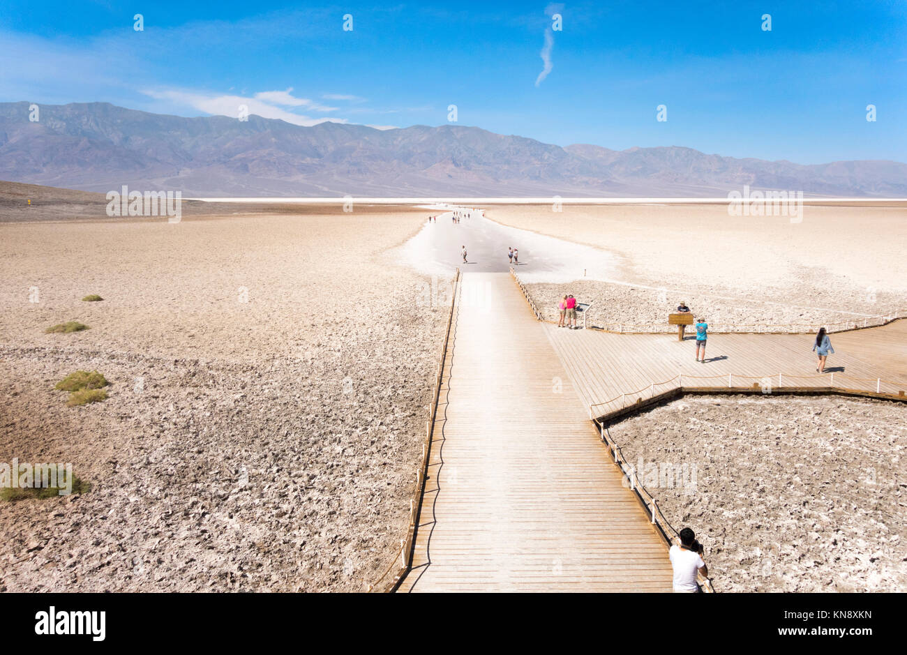Death Valley Badwater Basin. Trailhead and boardwalk with visitors. Death Valley National Park California - Stock Image