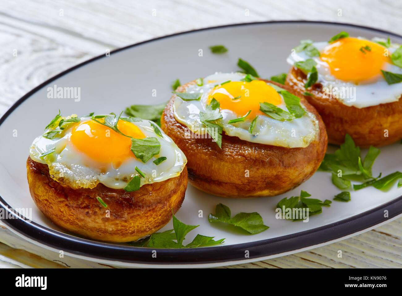 Tapas mushrooms with quail eggs from Spain pinchos pintxos. Stock Photo