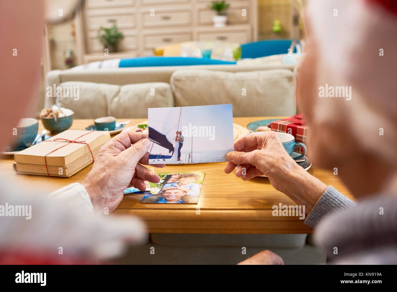 Elderly People Looking at  Photos - Stock Image