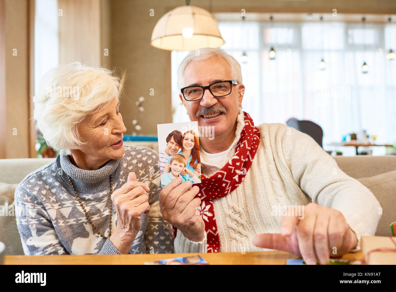 Senior Couple Remembering  Family on Christmas - Stock Image