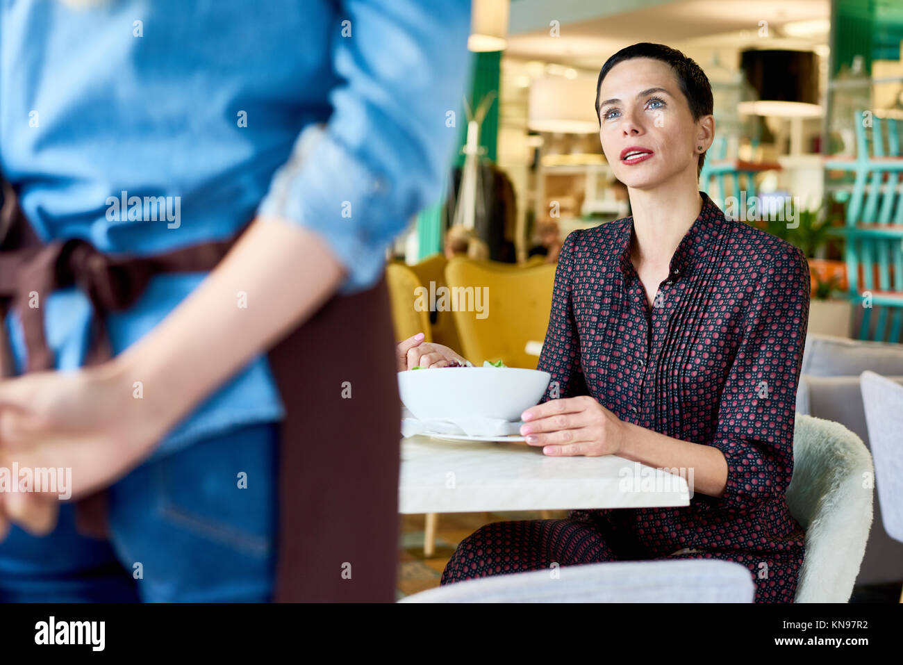 Woman Complaining in Cafe - Stock Image