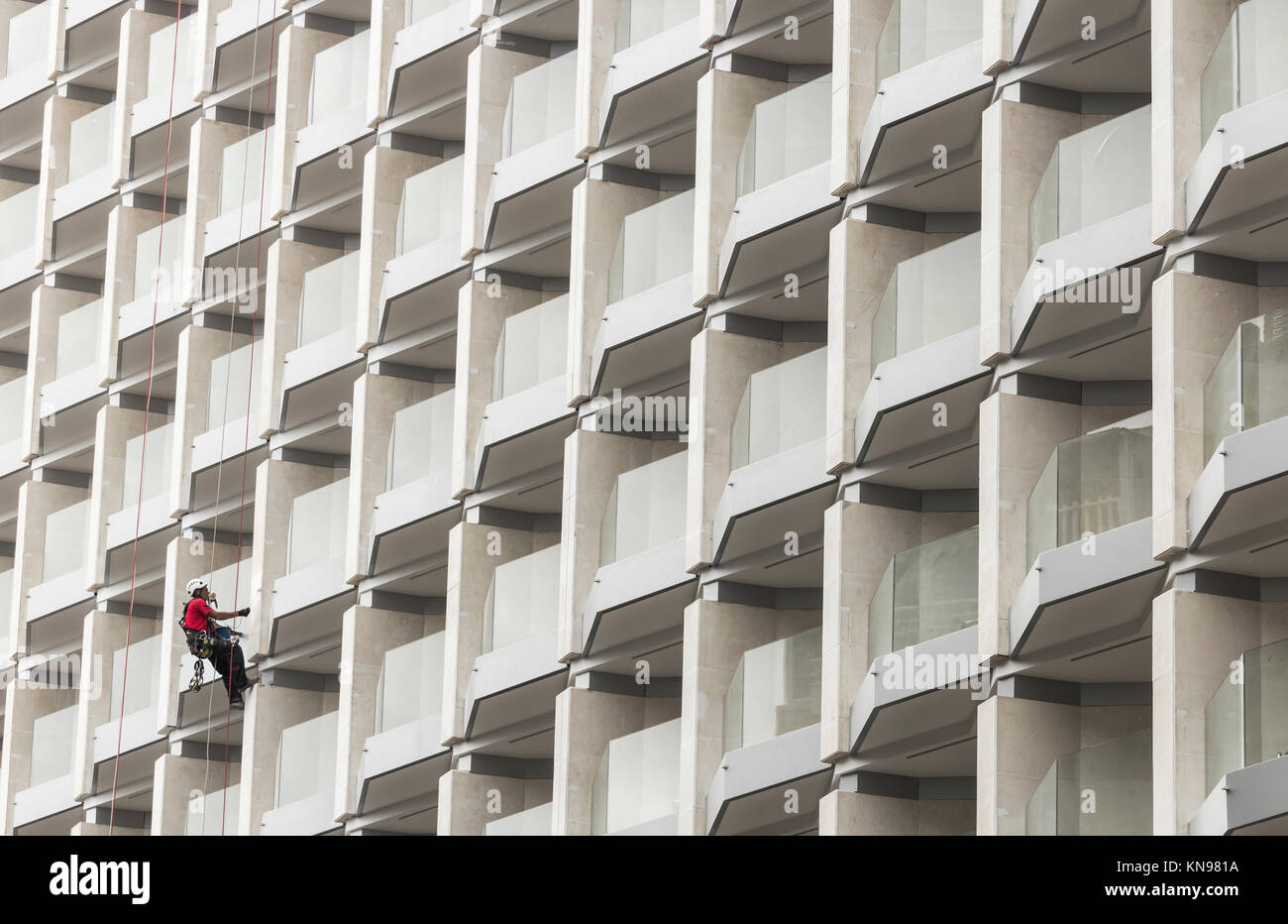 Workman painting hotel in Spain Stock Photo
