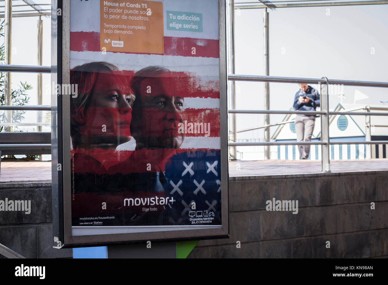 Image of Kevin Spacey promoting House of Cards on advertizing hoarding on telephone kiosk in Spain. - Stock Image