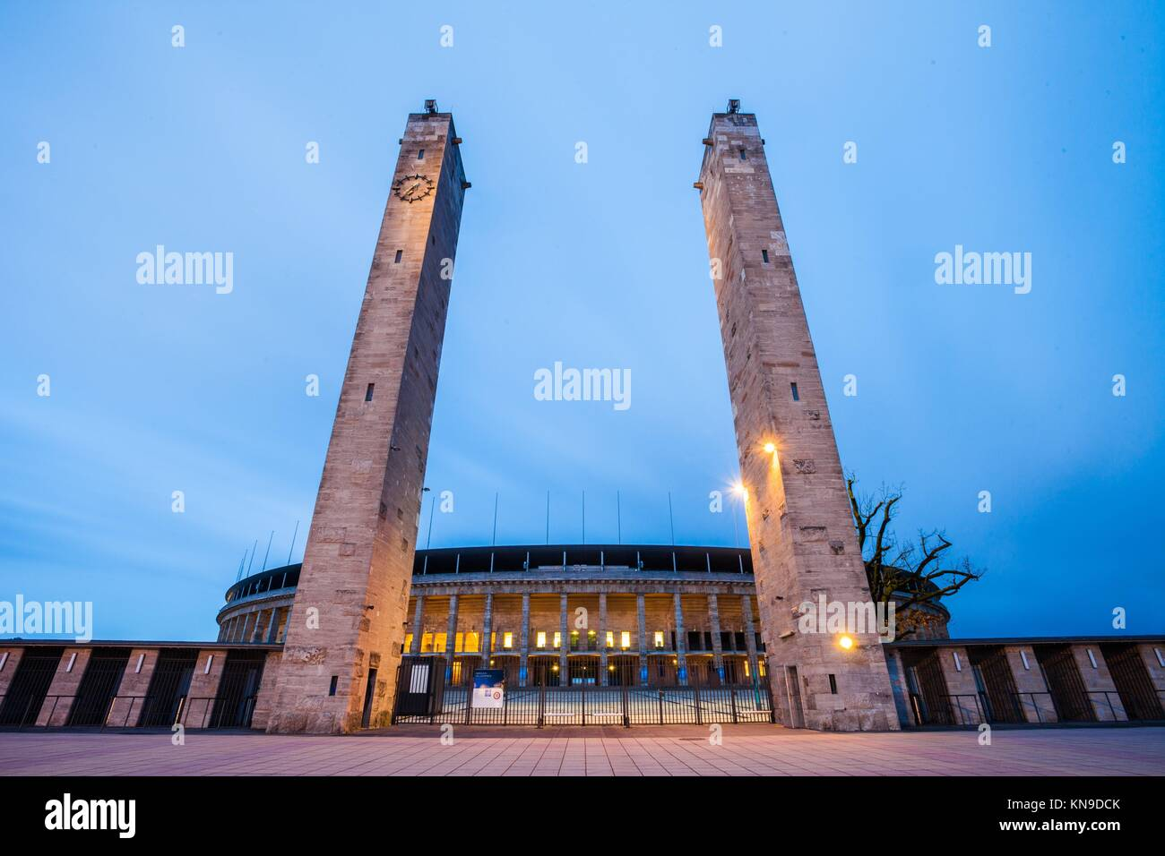 Berlin's Olympiastadion seen at twilight. - Stock Image