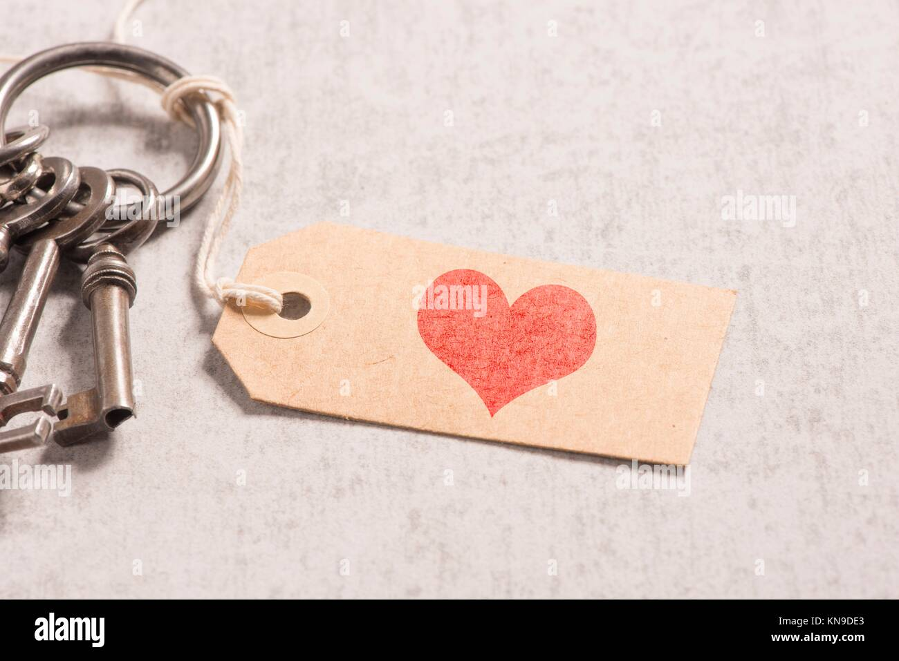 Heart Symbol On Key Tag Concept Of Love Romance And Vintage Stock