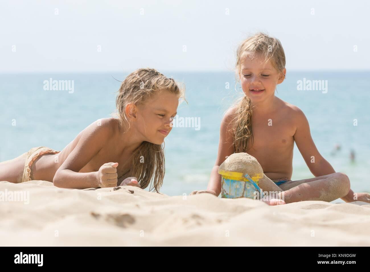 little girl sun Little Girl Sun Bathing On The Beach Stock Photo - Download Image Now