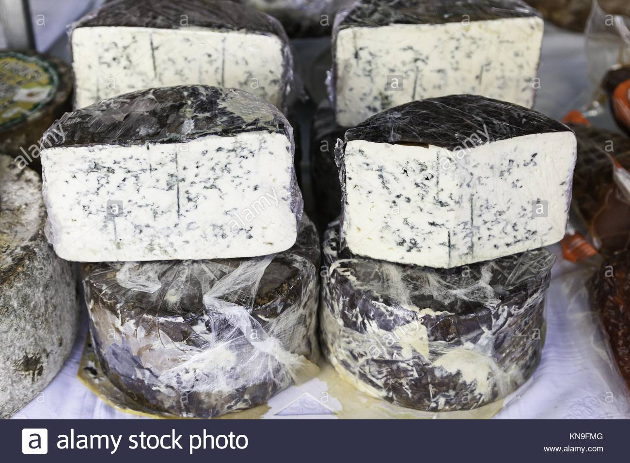 Blue Cheese in a market, detail of an old cheese on a post at a store, healthy food. - Stock Image