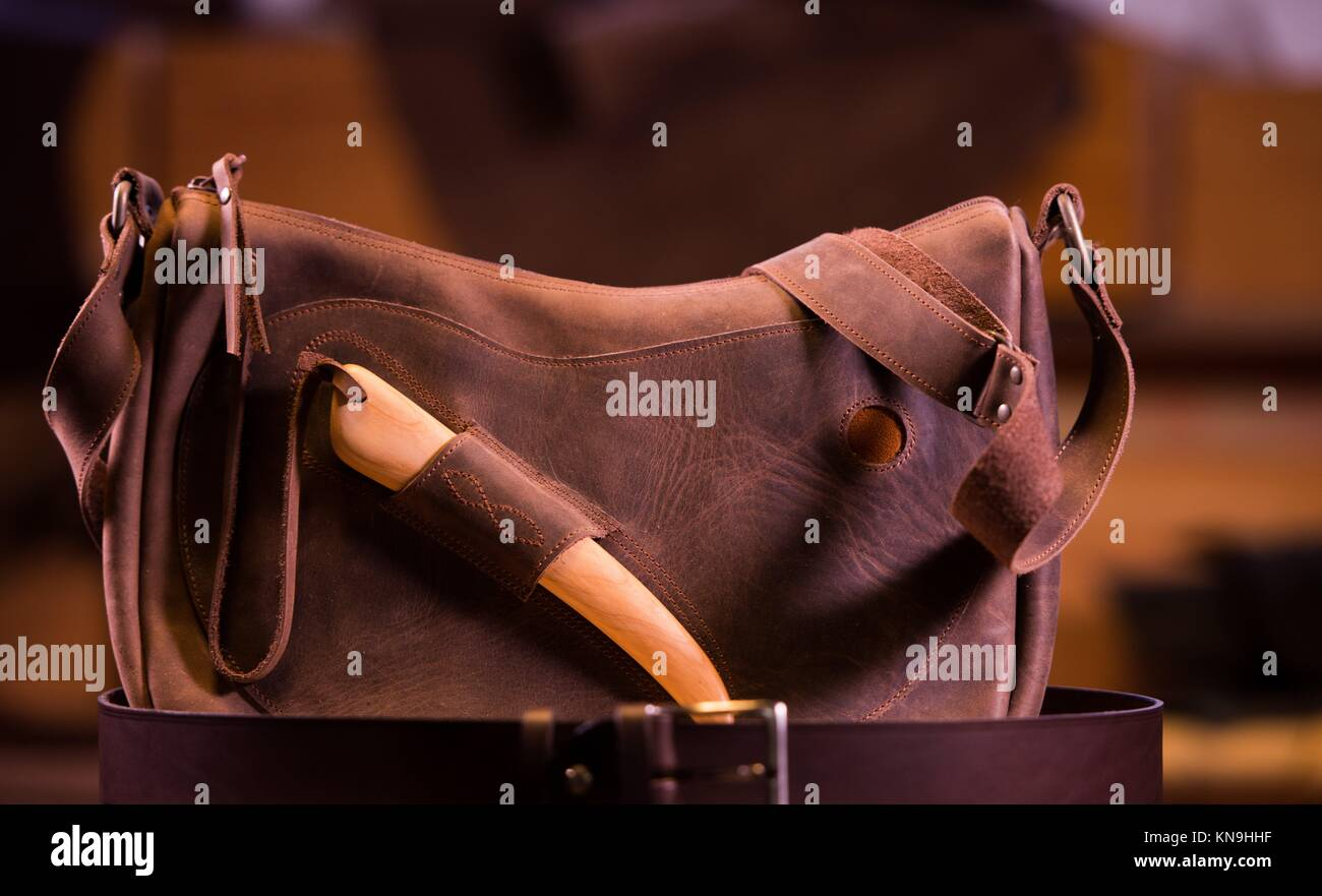 leather goods craftsman at work in his workshop, France. - Stock Image