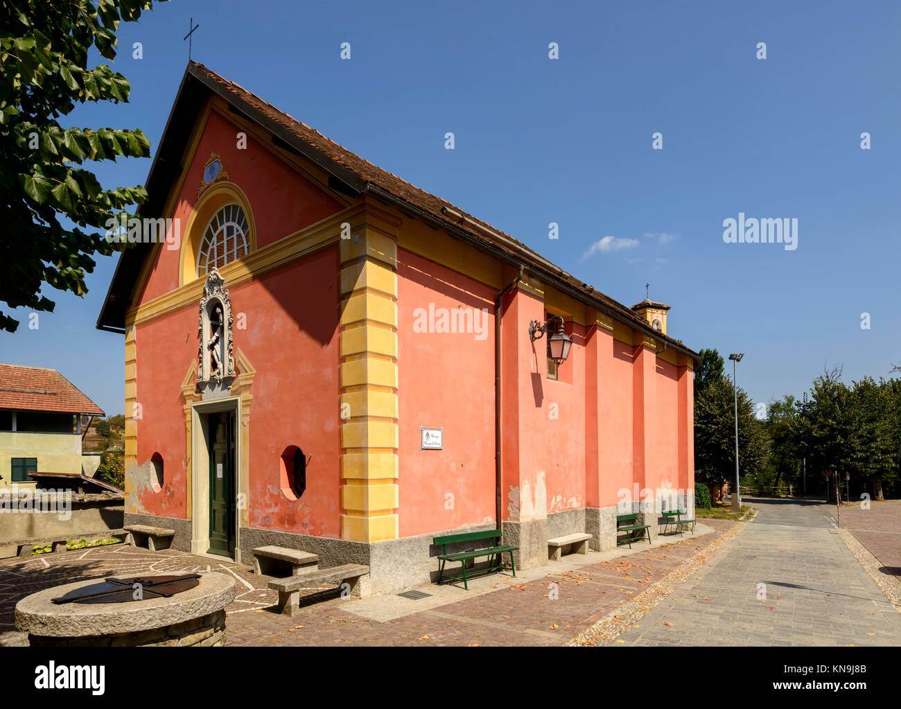 facade and side view of ancient small church of san Rocco in Sasello village, Ligure inland, Italy. Stock Photo
