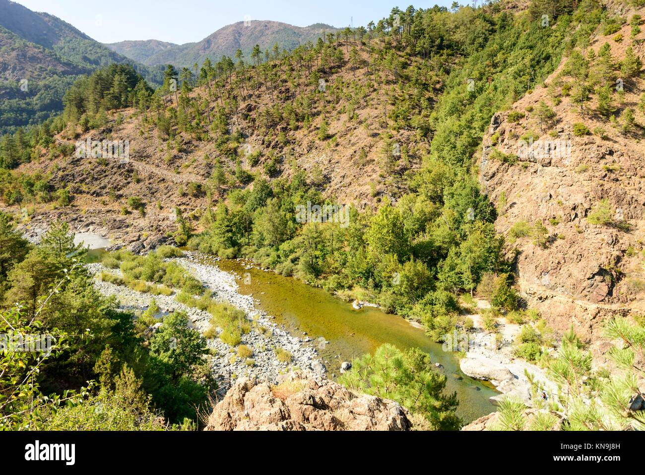 landscape with the clear waters of Orba river flowing in deep gorge in Ligure inland near Tiglieto, Italy. - Stock Image