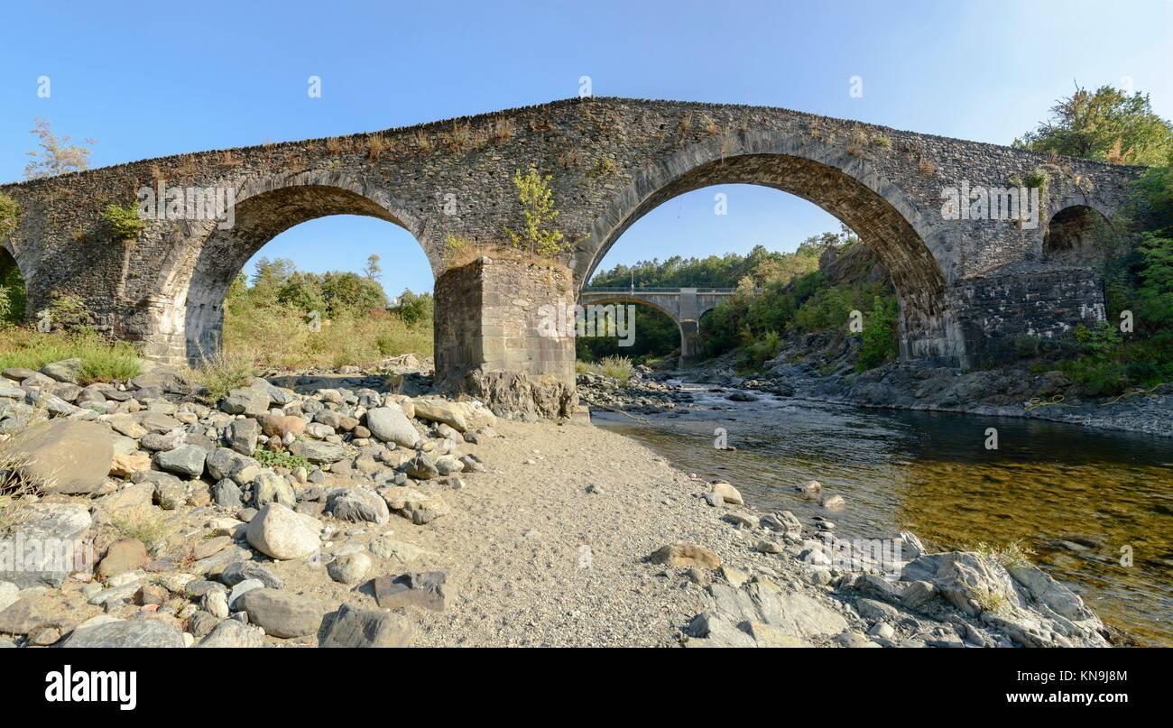 medieval bridge over Orba river near santa Maria alla Croce Cistercian abbey, Tiglieto, Ligure inland, Italy. - Stock Image