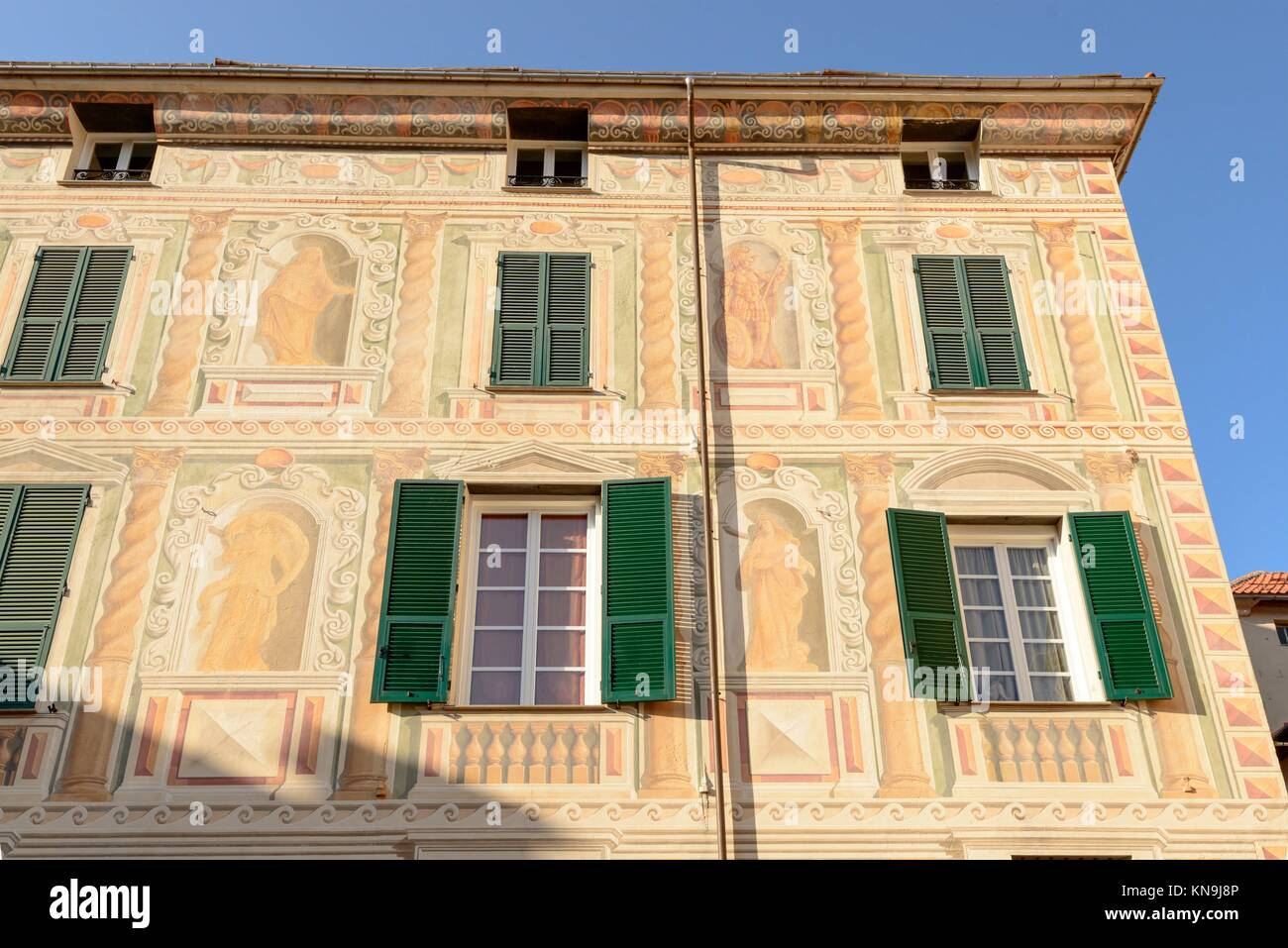 detail of highly decorated painted facade at Campo Ligure village, Ligure inland, Italy. - Stock Image