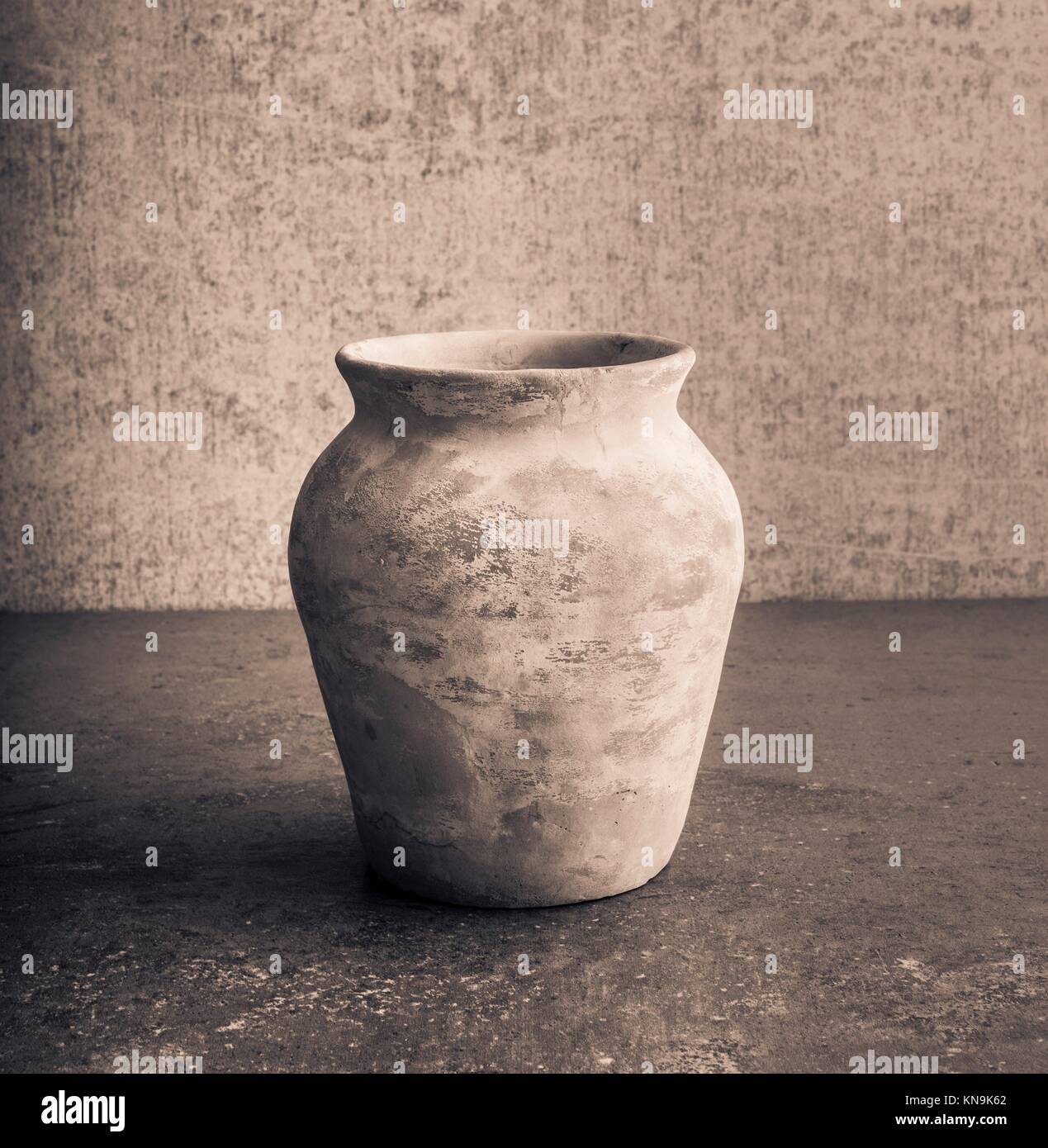 Old empty vase on stone table, still life. Concept of art, pottery object and vintage or antique decorative item. - Stock Image