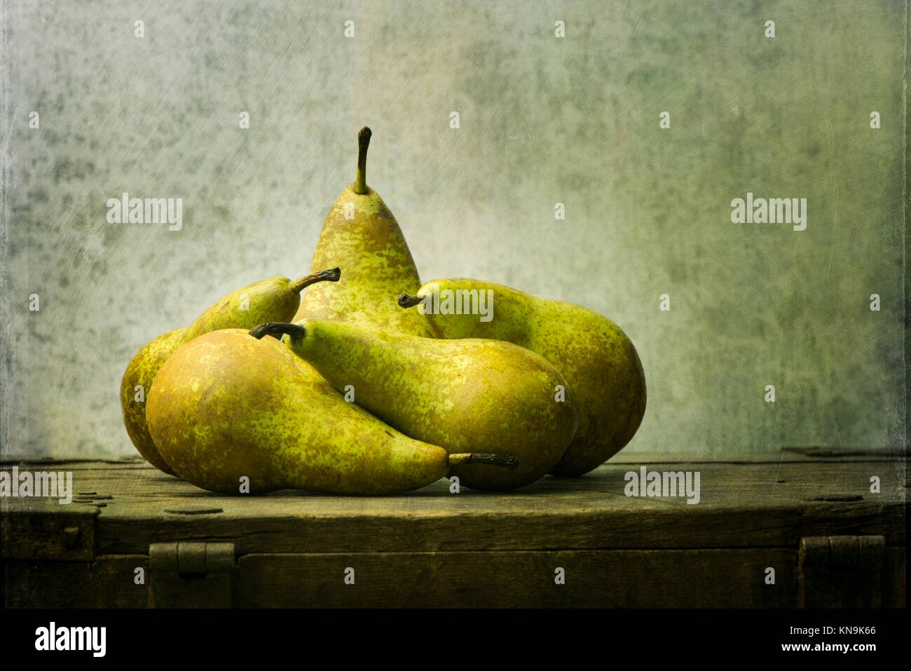 Fruit still life with pears on wooden table. Vintage rustic food image with artistic texture effect. - Stock Image