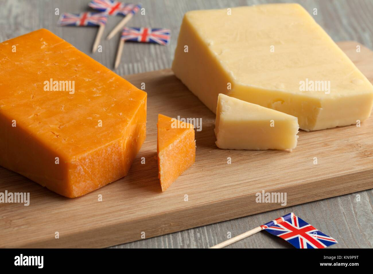 Pieces of traditional english cheese and flags Stock Photo