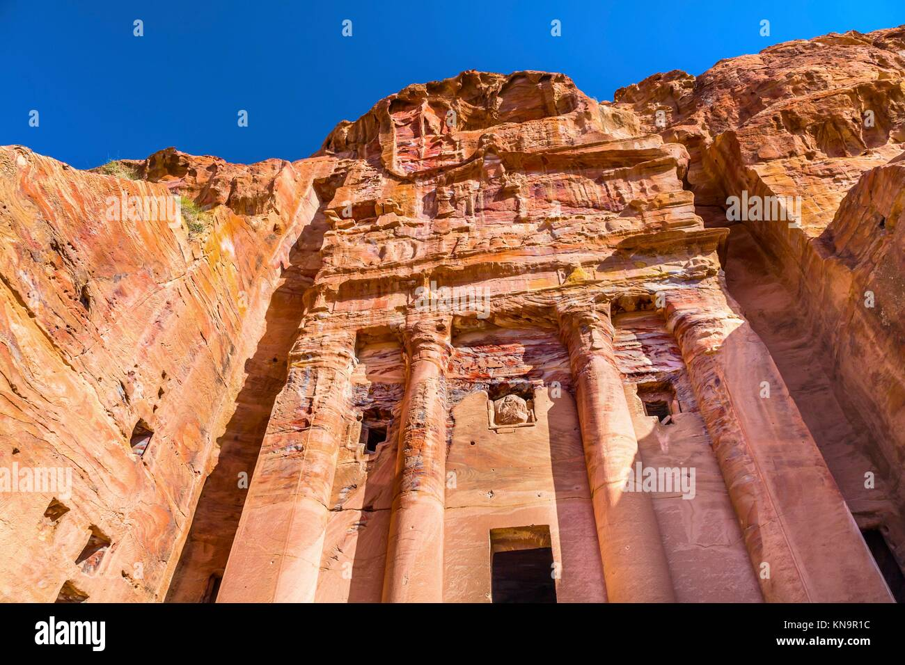 Royal Rock Tomb Arch Petra Jordan. Built by the Nabataens in 200 BC to 400 AD. Inside the Tombs, the red, orange, - Stock Image
