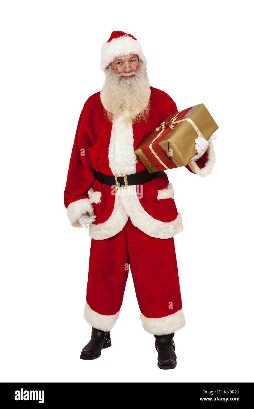 Santa Claus with real beard holding a gift in hand (isolated). - Stock Image