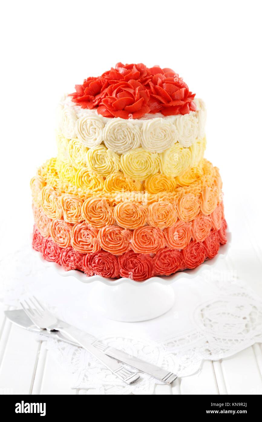 Wedding cake with buttercream roses. - Stock Image