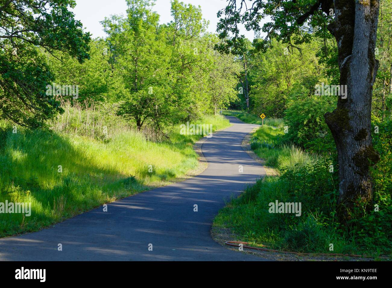 This paved bike and running path is free for the public to use to exercise. - Stock Image