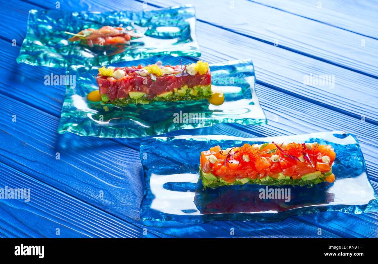 Salmon and Tuna Tartare with Anchovies tomato starter Tartar tapas. - Stock Image