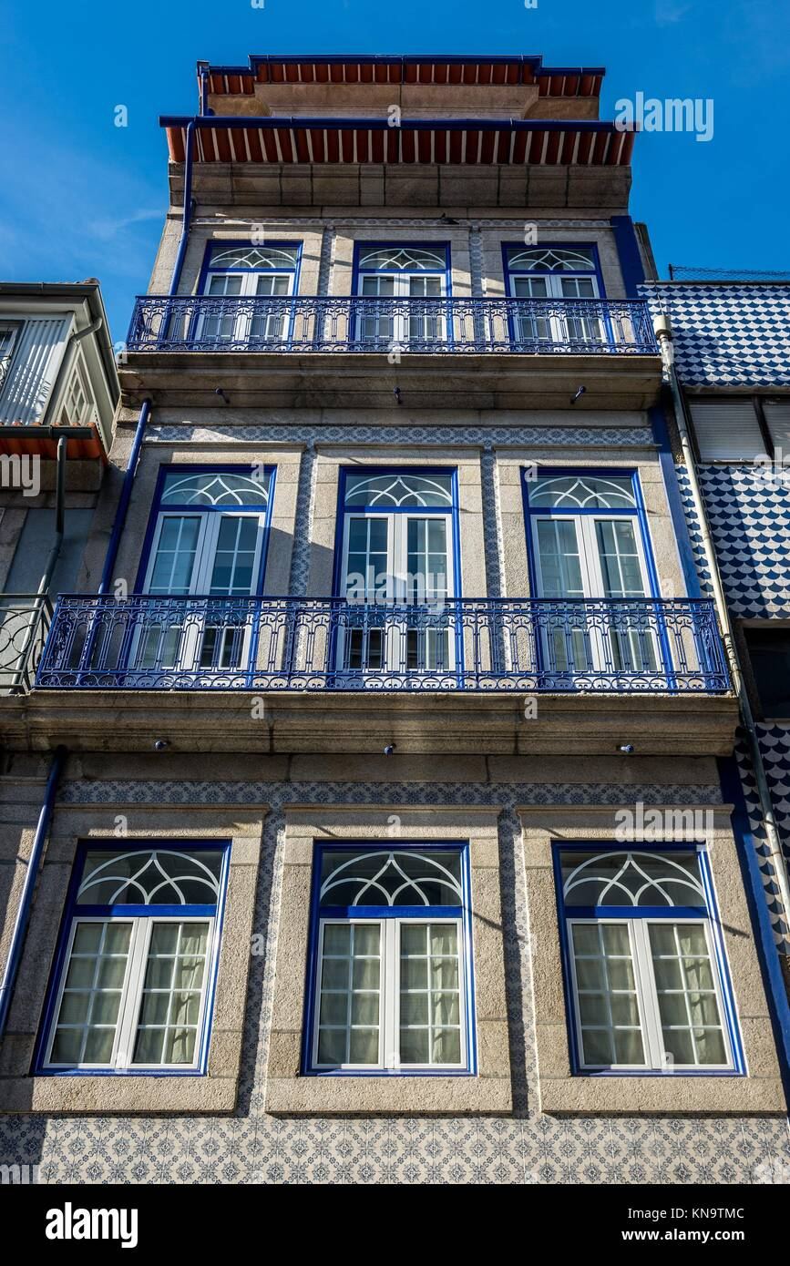 Townhouse with Azulejo tiles in Santo Ildefonso district of Porto city on Iberian Peninsula, second largest city - Stock Image