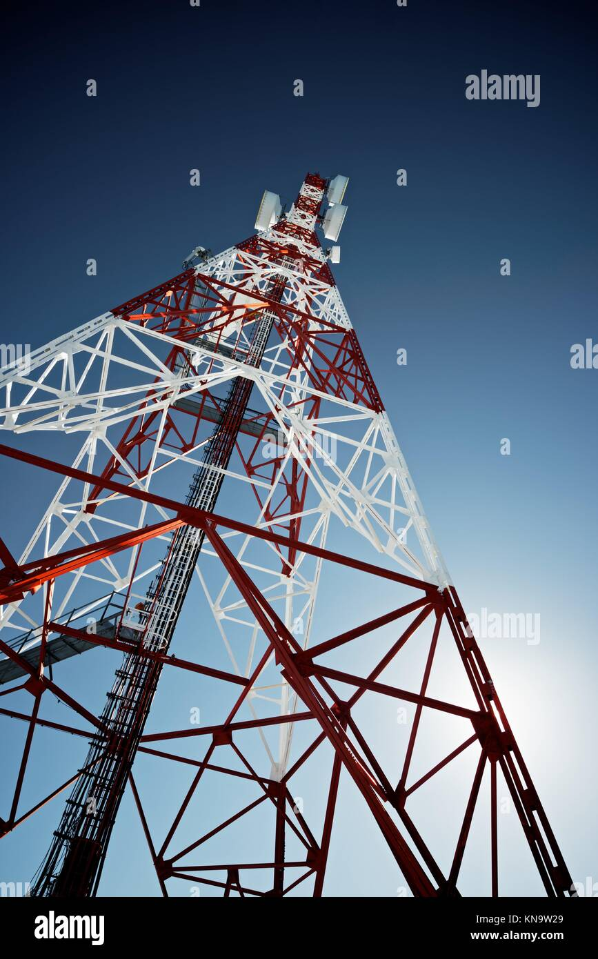 Telecommunications tower with clear blue sky. - Stock Image