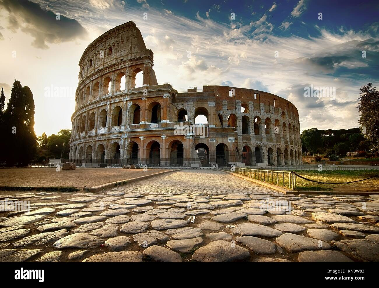 Cloudy dawn over roman Colosseum in Italy. - Stock Image