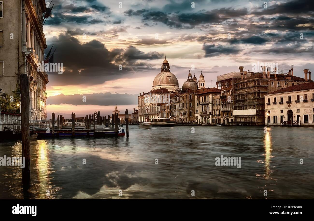Dramatic sky over Grand Canal and Basilica di Santa Maria della Salute in Venice at sunset, Italy. Stock Photo