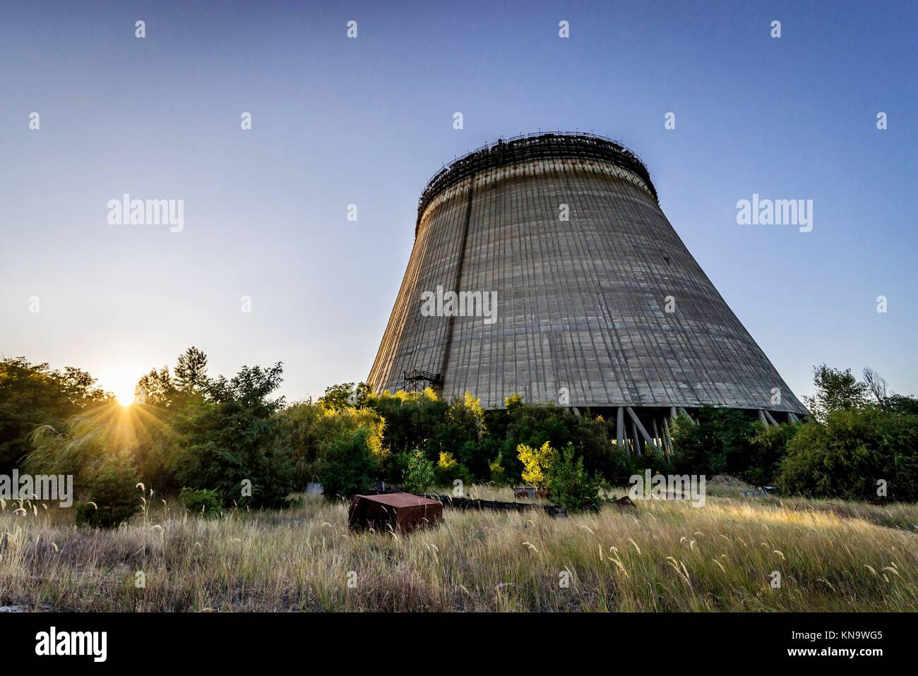 Cooling tower of Chernobyl Nuclear Power Plant in Zone of Alienation around the nuclear reactor disaster in Ukraine. - Stock Image