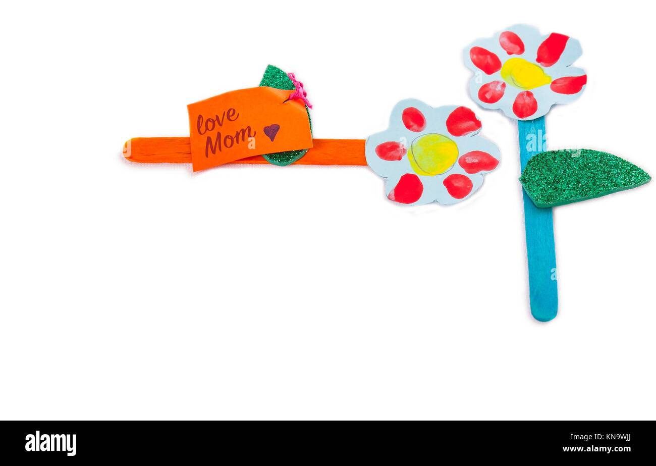 Poster board spring flowers made with recycled materials by nursery children for Mother's Day. Isolated over - Stock Image
