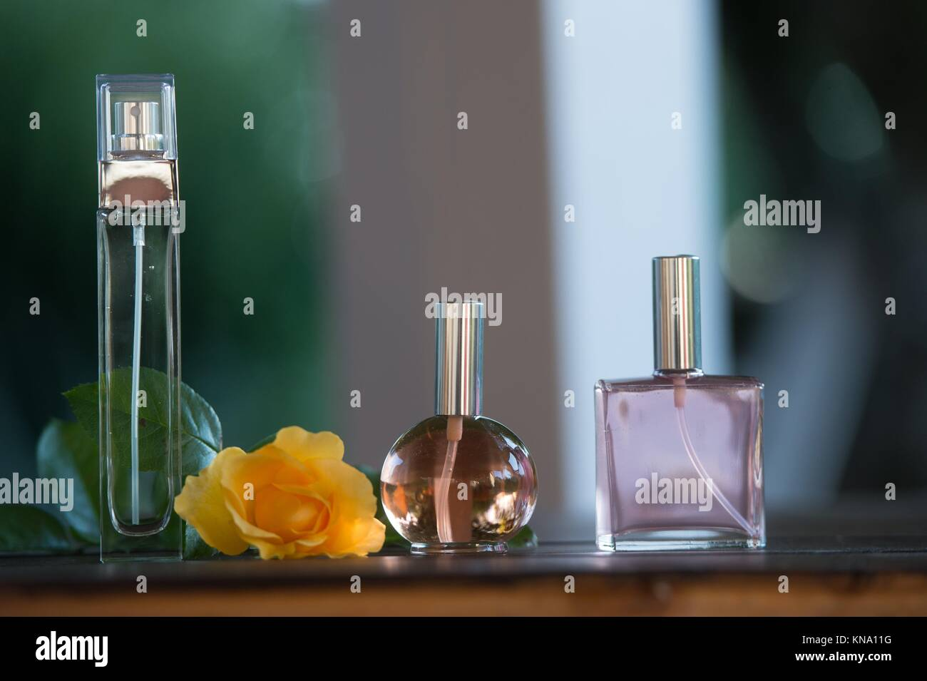 Luxurious Perfume bottles on table outdoor, France. - Stock Image