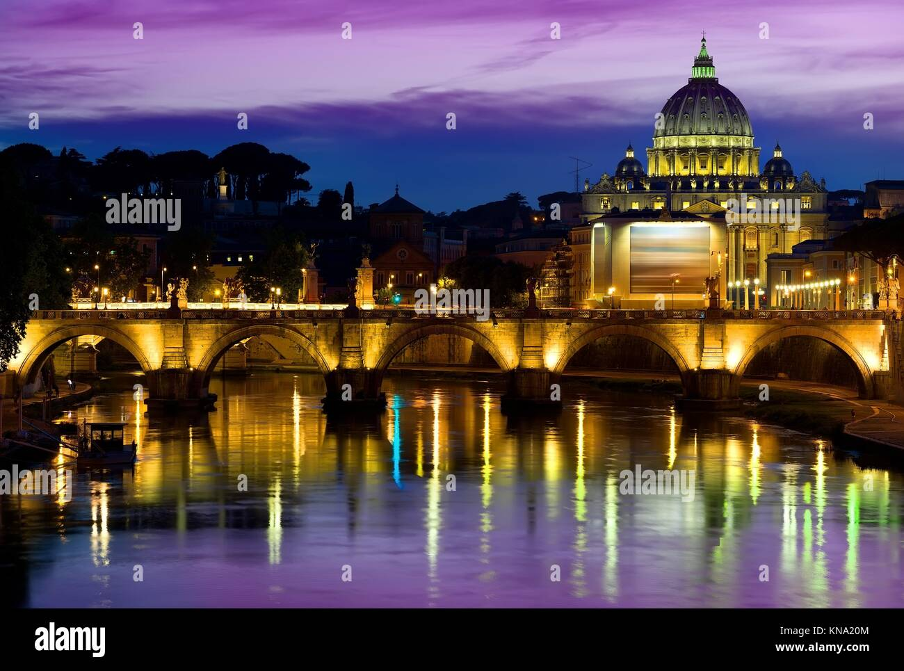 Purple sky over Vatican at sunrise, Italy. - Stock Image
