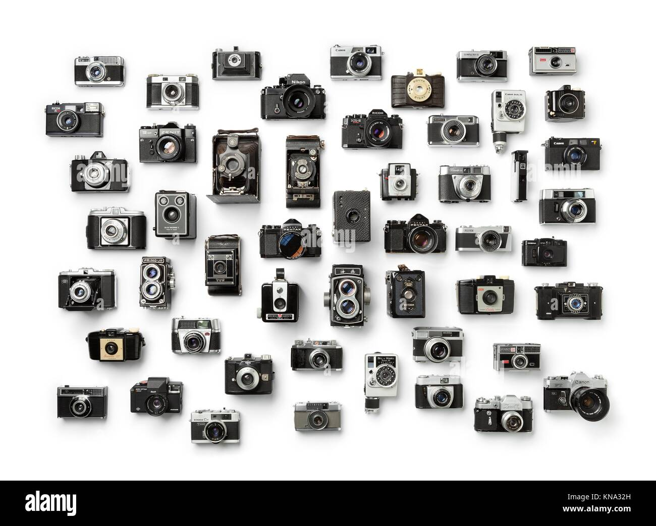 Collection of old analog different camera's on white background. Stock Photo