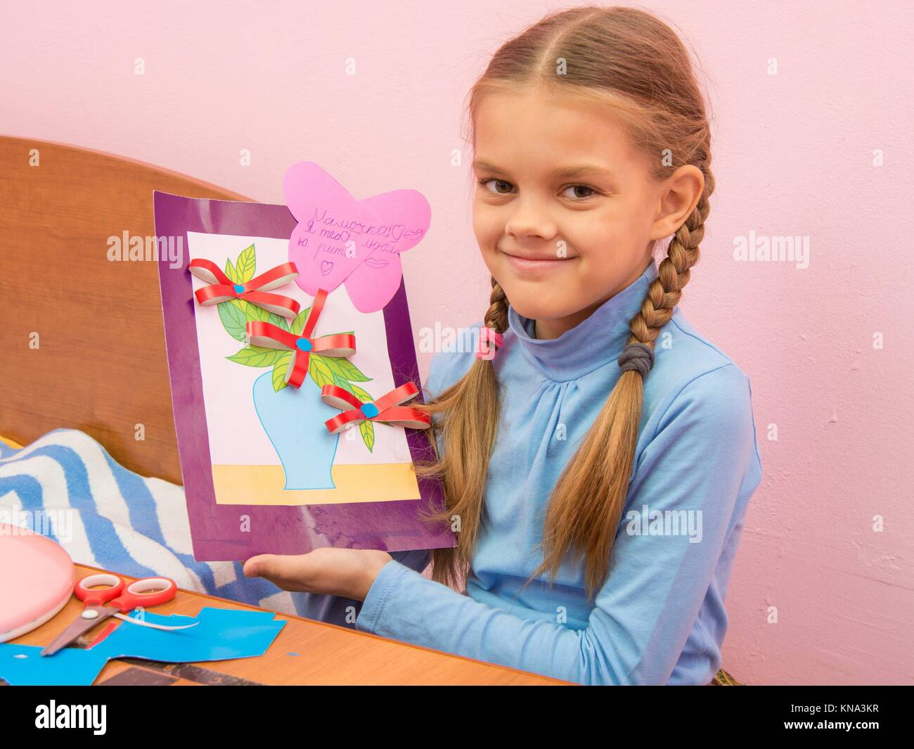 The girl made a birthday card for mom on Mothers Day. Stock Photo