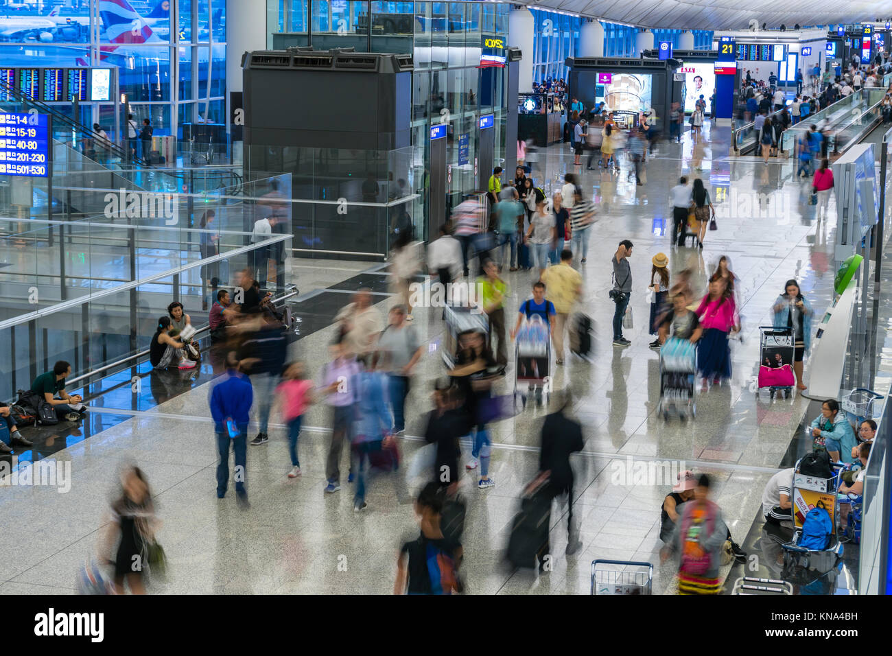 Travellers in the Kong Kong International Airport - Stock Image