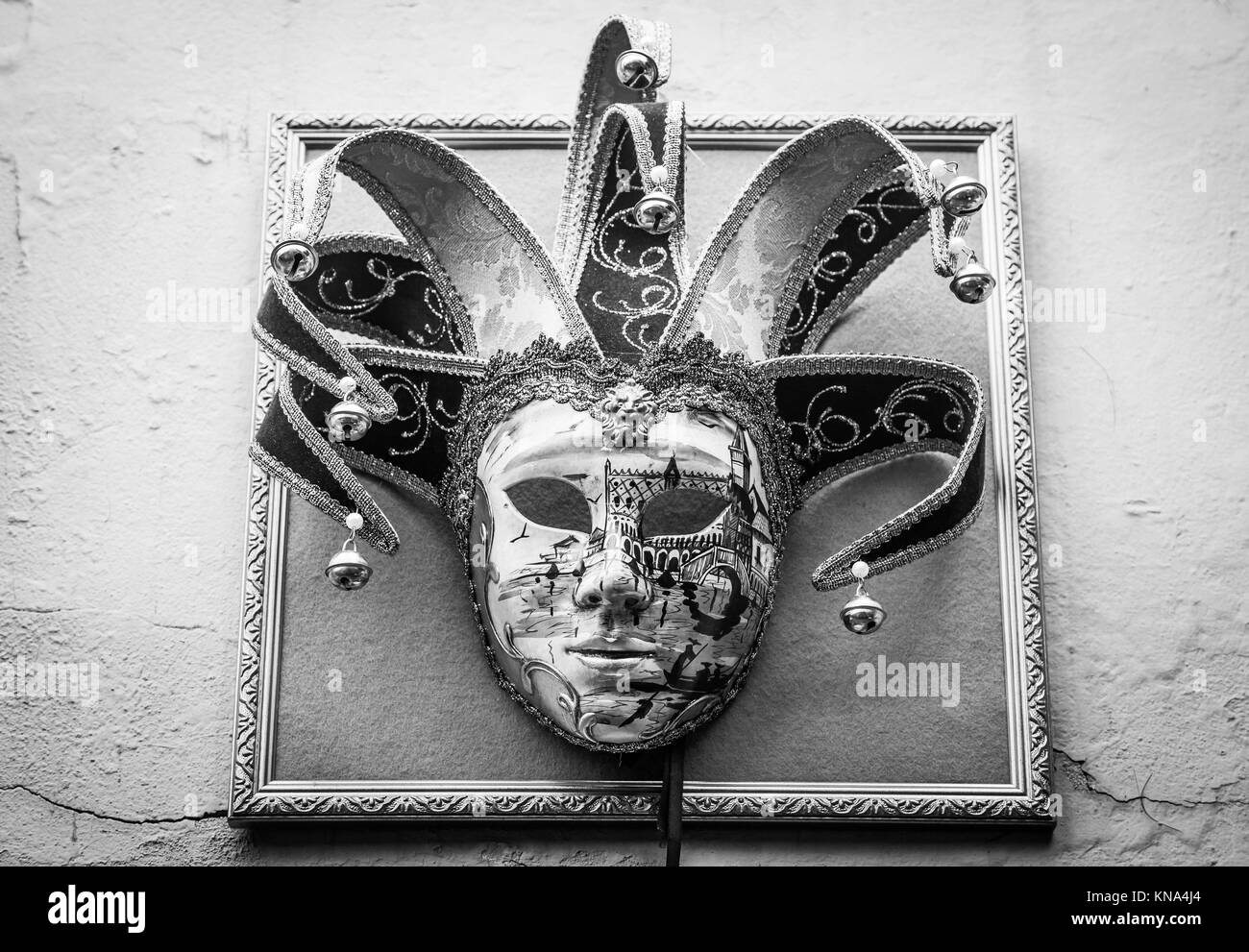 Traditional Venetian Mask on old wall background. - Stock Image