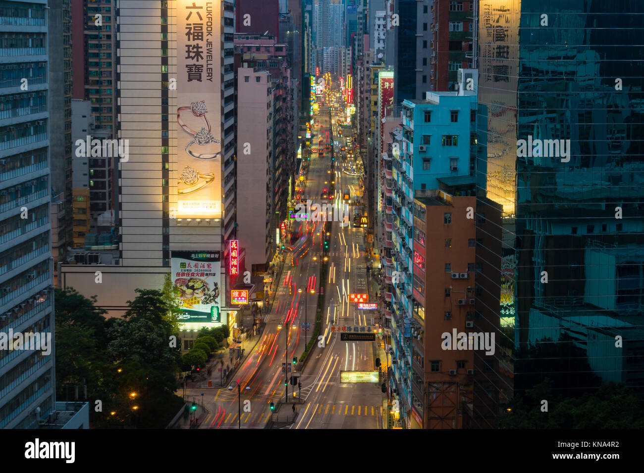 Traffic in a busy street in Hong Kong Stock Photo